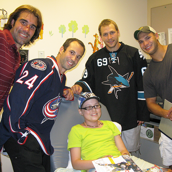 NOFCC Client with Hockey Stars